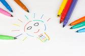 Renkli işaretleri ile çizilmiş bir ampul — Stok fotoğraf