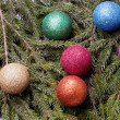 Colored balls are on the fir trees. — Stock Photo