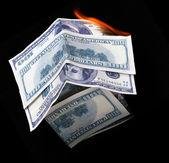 House of dollar bills. fire — Stock Photo