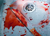 Bloody kitchen knife — Stock Photo