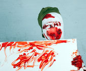 Scary bloody zombie wearing a cap — Stock Photo
