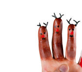 Three funny reindeer painted on the fingers — Stock Photo