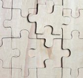 Wooden puzzles. — Stock Photo