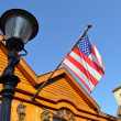 House and flag — Stock Photo