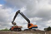 Loading a dumper truck — Stockfoto