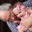 Grandfather and granddaughter — Stock Photo #43800529