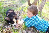 Boy and puppy — Stock Photo