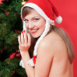 Young beautiful woman near the Christmas tree. — Stock Photo