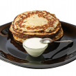 Pancakes with sour cream. — Stock Photo
