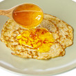 Pancakes with honey. — Stock Photo