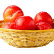 Red plums in basket. — Stock Photo #22793514