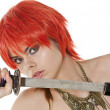 Royalty-Free Stock Photo: Redheaded woman with a katana .