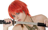 Redheaded woman with a katana . — Stock Photo