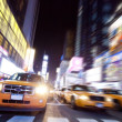 New York Taxi on Time Square in night — Stock Photo #13616069