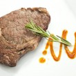 Grilled Sirloin steak with rosemary - Stock Photo