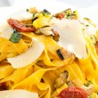 Fettuccine with dried tomatoes and parmesan — Stock Photo