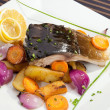 Grilled carp with vegetable garnish — Stock Photo #35624095