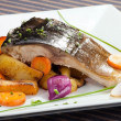 Grilled carp with vegetable garnish — Stock Photo #35624103