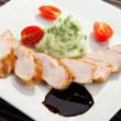 Pork tenderloin w potato puree with young peas — Stock Photo