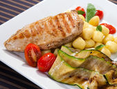 Grilled chicken breast w grilled aubergine and gnocchi — Stock Photo