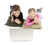 Children in business watching the Laptop and calling — Stock Photo