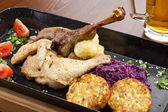 Baked duck and chicken legs — Stock Photo