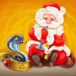 Santa - Snake charmer. — Stock Photo