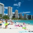 Tourist sunbathing and surfing on the Waikiki beach in Hawaii. — ストック写真