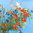 Wild flowers on a blue background — Foto Stock
