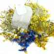 Tea bag from mix herbs,cornflower,hypericum,immortele,and chamomile — Stock Photo