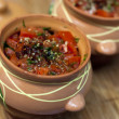 Food in clay pots — Stock Photo