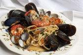 Pasta with fresh mollusk — Stock Photo