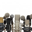 Conference meeting microphones on white background — Stock Photo #20990559