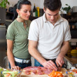 Young happy couple preparing lunch — Stock Photo
