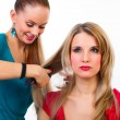 Beautiful young woman gets a hairdo — Stock Photo #32386757
