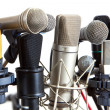 Several kind of conference meeting microphones on white — Stock Photo