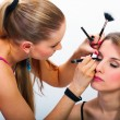 Make-up artist applying mascara  — Stockfoto