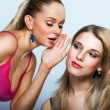 Two young women sharing secret — Stock Photo #32386967