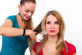 Beautiful young woman gets a hairdo — Stock Photo