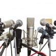 Stock Photo: Microphones prepared for conference meeting.