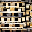 Piles of wooden aged pallets. — Stock Photo