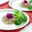 Aspic with beetroot horseradish - Stock Photo