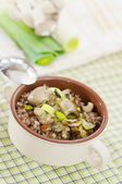 Buckwheat with oyster mushrooms and leeks — Stock Photo