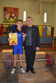 First medal of the young weight-lifter — Stock Photo