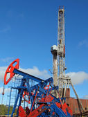 Oil and gas industry. Work of oil pump jack on a oil field. Borehole drilling oil well — Stock Photo