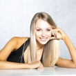 Beautiful young blonde girl in a black top — Stock Photo