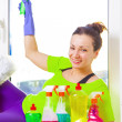Woman cleaning window — Stock Photo #43791477