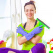 Woman cleaning window — Stock Photo #43791505