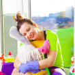 Woman cleaning window — Stock Photo #43791521