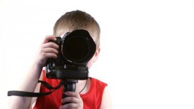 Little boy with a camera — Стоковое видео